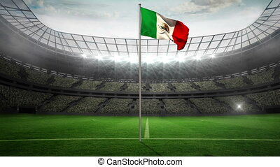 Mexico national flag waving on flagpole in football stadium...