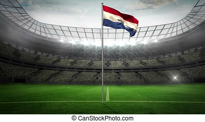 Netherlands national flag waving on flagpole in football...