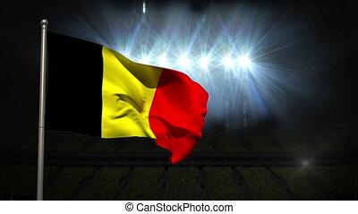 Belgium national flag waving on flagpole on black background...