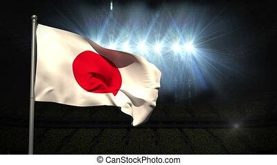 Japan national flag waving on flagpole on black background...