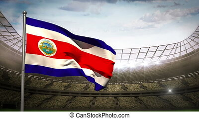 Costa Rica national flag waving on flagpole in football...