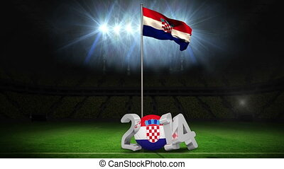 Croatia national flag waving on football pitch on black...
