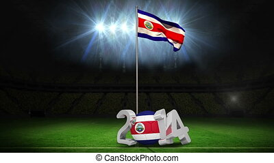Costa Rica national flag waving on football pitch on black...