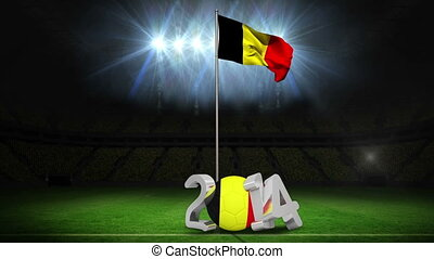 Belgium national flag waving on football pitch on black...