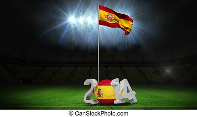 Spain national flag waving on football pitch on black...