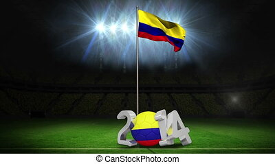 Colombia national flag waving on football pitch on black...