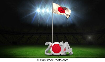 Japan national flag waving on football pitch on black...