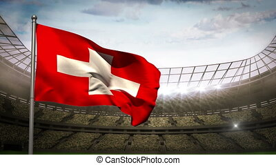 Switzerland national flag waving on flagpole on stadium...