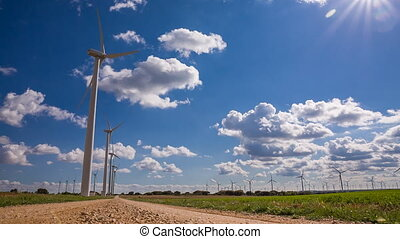 Wind turbines - Modern Wind turbines large array on a cloudy...