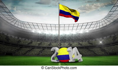 Colombia national flag waving in football stadium with 2014...