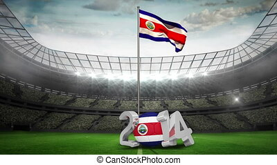 Costa Rica national flag waving in football stadium with...