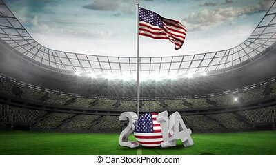 American national flag waving on flagpole in football...