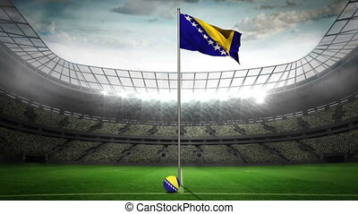 Bosnia national flag waving on flagpole in football stadium...
