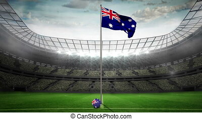 Australia national flag waving on flagpole in football...