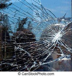 Broken Window - Broken Glass with outdoor street reflection....