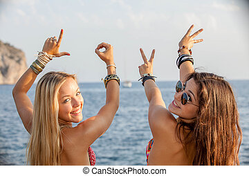 young people happy on spring vacation or summer holiday