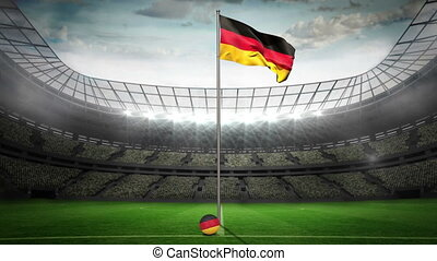 Germany national flag waving on flagpole in football stadium...