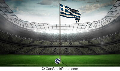 Greece national flag waving on flagpole in football stadium...