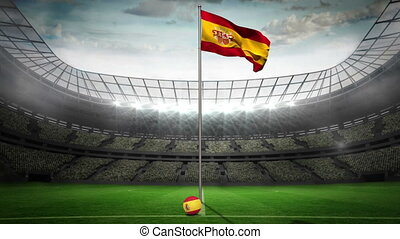 Spain national flag waving on flagpole in football stadium...