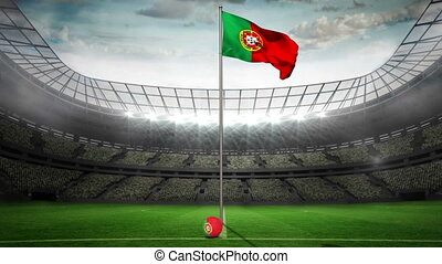 Portugal national flag waving on flagpole in football...