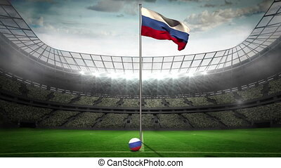 Russia national flag waving on flagpole in football stadium...