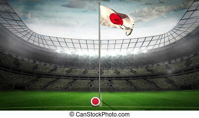 Japan national flag waving on flagpole in football stadium...