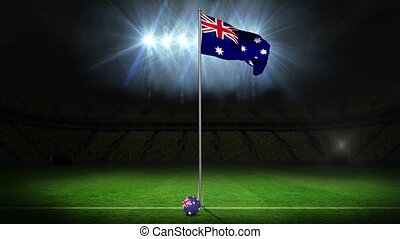 Australia national flag waving on flagpole on football pitch...