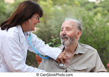 dr with stethoscope checking senior patient. - dr with...