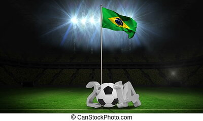Brazil national flag waving on flagpole on football pitch...