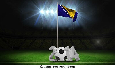 Bosnia and herzegovina national flag waving on flagpole on...