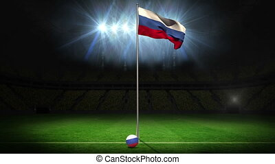 Russia national flag waving on flagpole on football pitch...