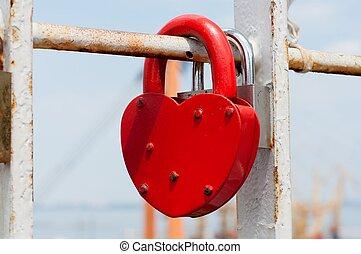 Heart Lock - Heart lock on the railings. Closeup.