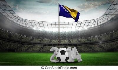 Bosnia national flag waving on pole with 2014 message on...