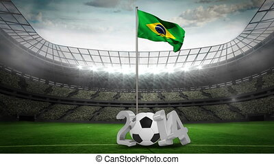 Brazil national flag waving on pole with 2014 message on...