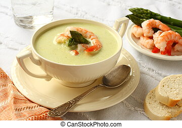 Delicious cream soup with asparagus and shrimp Selective...