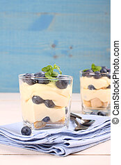 Fresh blueberry layered desert with mascarpone cream and...