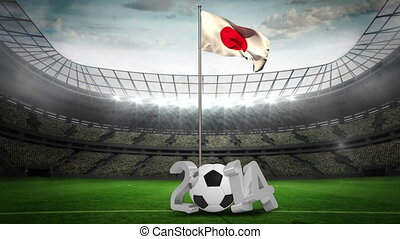 Japan national flag waving on pole with 2014 message on...