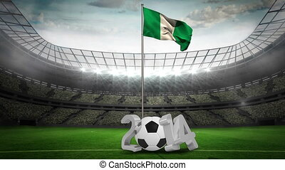 Nigeria national flag waving on pole with 2014 message on...