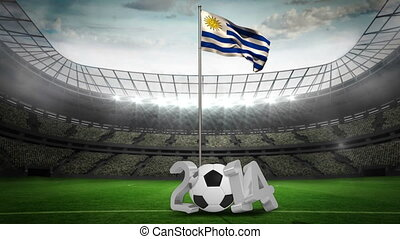 Uruguay national flag waving on pole with 2014 message on...