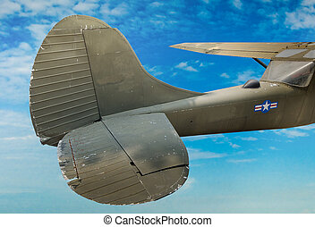 Vintage backside plane of world war on blue sky background