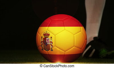 Football player kicking Spain flag ball - Football player...