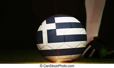 Football player kicking Greece flag ball - Football player...