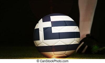 Football player kicking Greece flag ball - Football player...