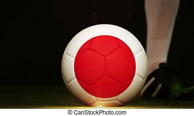Football player kicking Japan flag ball - Football player...