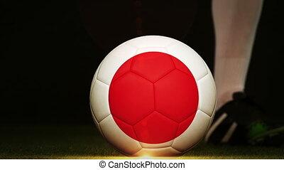 Football player kicking Japan flag ball - Football player...