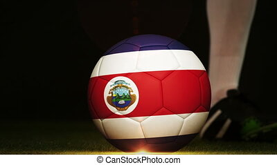 Football player kicking Costa Rica flag ball - Football...