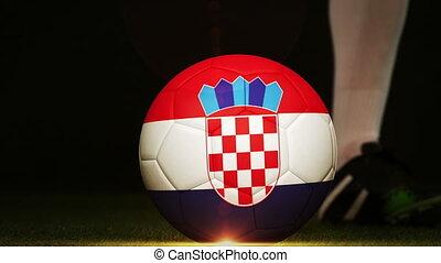 Football player kicking Croatia flag ball - Football player...