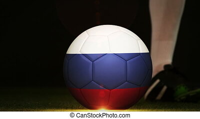 Football player kicking Russia flag ball - Football player...