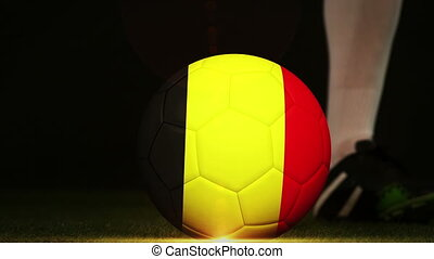 Football player kicking Belgium flag ball - Football player...