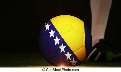 Football player kicking Bosnia flag ball - Football player...
